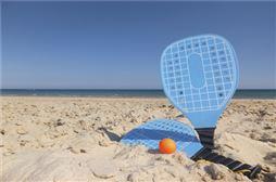 Playa San Juan raqueta en la arena